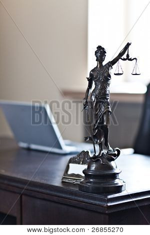 """Blind Lady Justice"" statue on desk"