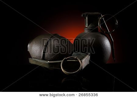two hand grenades on dark background
