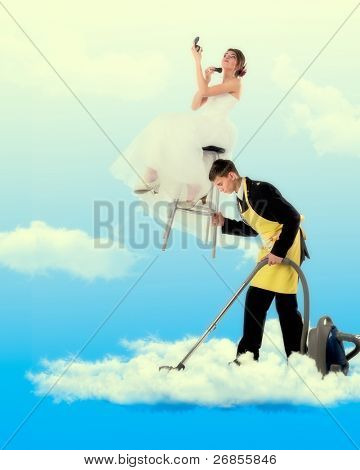 Woman sitting on the stool holding a mirror, man hoovering in clouds.