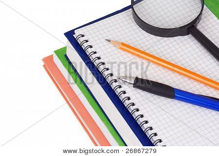 books, notebook, magnifying glass and pen isolated on white background