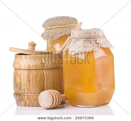 jars and pot full of honey isolated on white background