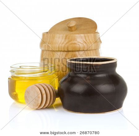 jars and pot of honey isolated on white background