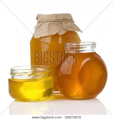 pot of honey and jar isolated on white background