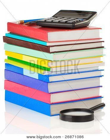 pile of books and pens isolated on white background
