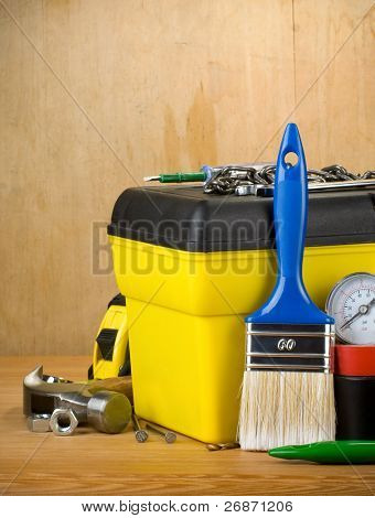 set of tools and toolbox on wood texture