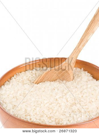 rice in wooden plate and spoon isolated on white background