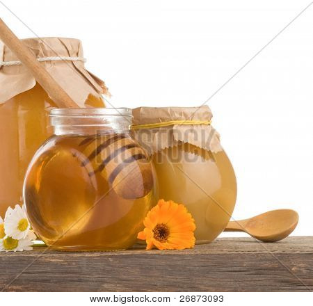 honey in jar isolated on white background