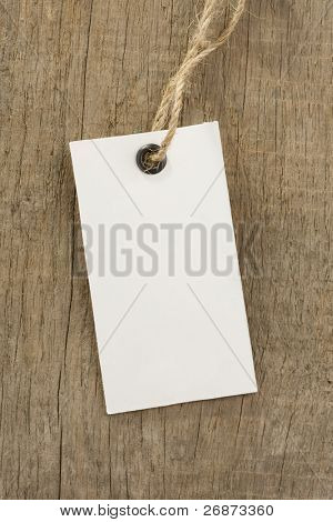 price paper tag over wood background texture