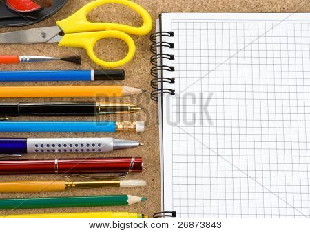 back to school and accessories on checked notebook at wood texture