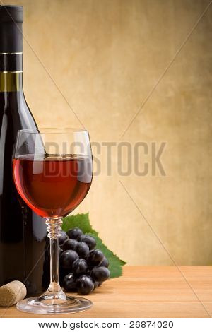 wine in glass and bottle at wood texture