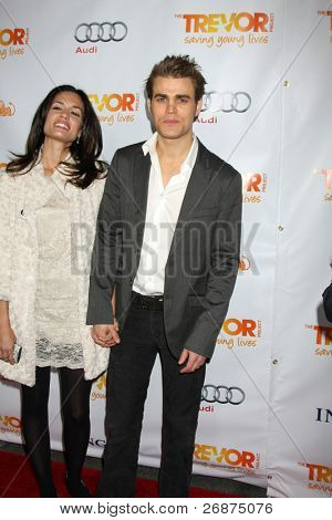 LOS ANGELES - DEC 4:  Torrey DeVitto and actor Paul Wesley arrives at