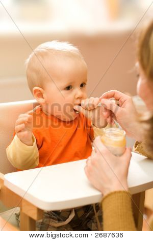 Feeding A Little Baby Boy