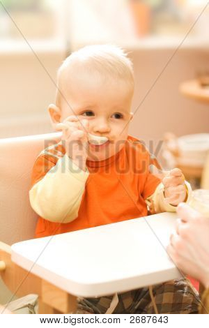 Baby Boy Playing With Spoon