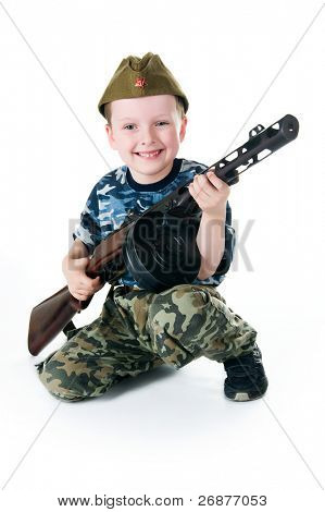 Little soldier with the submachine gun on white background