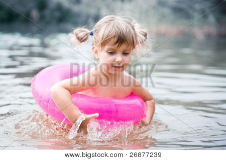Little wet girl with air buoy