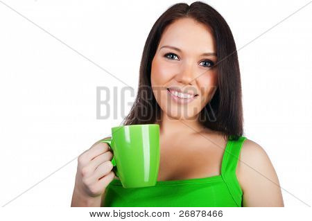 Pretty young women with the cup of tea on white