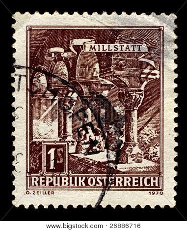 AUSTRIA-CIRCA 1970:A stamp printed in AUSTRIA shows image of Millstatt Abbey is a former monastery at Millstatt in the Austrian state of Carinthia, which was established about 1070, circa 1970.