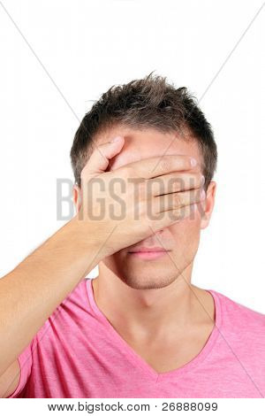 Portrait of Man covering his face with a palm over white background