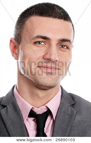 Portrait of a handsome young happy businessman in suit over white background