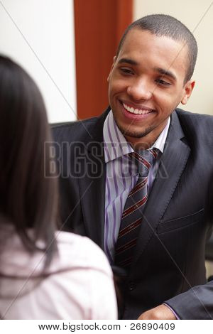 Two businesspartners having a conversation and laughing