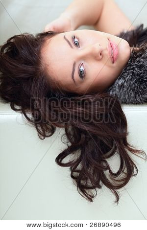 Young beautiful girl with long curly hair