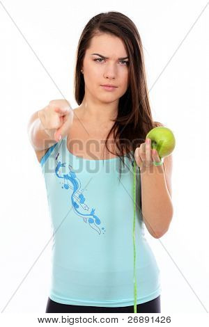 Young fit woman tells you to eat healthy food