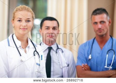 Female Doctor standing in Front of her team in the hospital