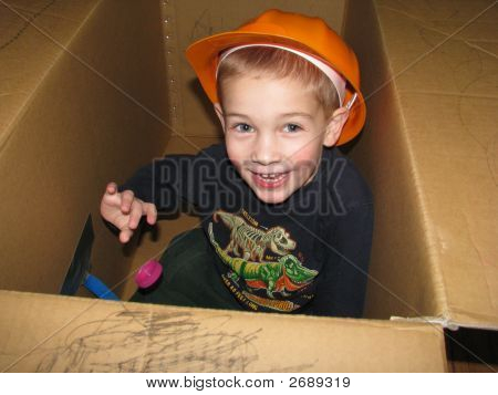 Boy Plays In Box