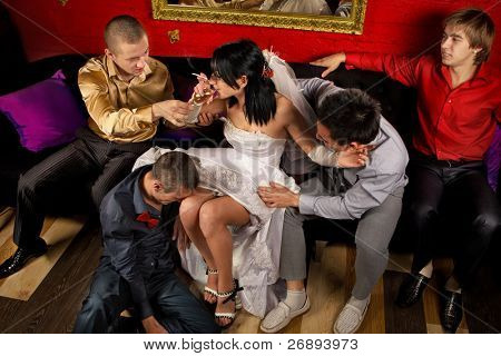 Crazy wedding party in night club. Friends of groom make a drunkard of bride