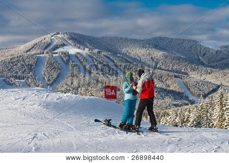 winter mountain landscape with skiing slope