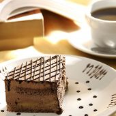 stock photo of bakeshop  - close up shot of a sliced cake and tea - JPG