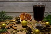 Hot Red Mulled Wine And Red Sicilian Dried Orange Slices. Golden Beads, Glittering Golden Christmasb poster