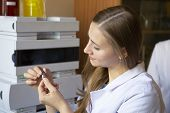 Young Scientist Works In Modern Biological Lab poster