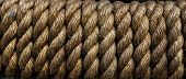 Texture Tightly Wound Rope Close Up. Low Key. Ideal For Background. Periodicity, Repetition, Rhythm  poster
