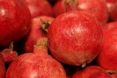 Ripe Pomegranates Close-up, Selective Focus. Red Pomegranate Fruits On The Market, Natural Backgroun poster