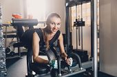 Happy Girl Performs Leg Muscle Strength Exercise. Smiling Girl Doing Physical Training On A Training poster