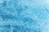 Blue ice texture, winter background, texture of ice surface, close-up. poster