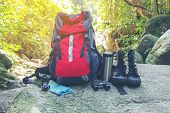 Hiking Travel Gear On Glasses. Items Include Hiking Boots, Cup, Map,binoculars. Flat Lay Of Outdoor  poster