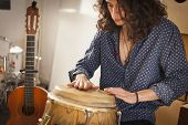 Young Gypsy Percussionist Hands While Playing Congas Instrument On A Rehearsal Studio With Spanish G poster