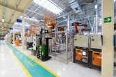 Car Manufacturing Plant. Automotive Shop. The Assembly Line For Manufacturing Cars. poster