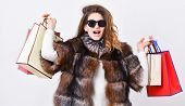 Woman Shopping Luxury Boutique. Girl Wear Sunglasses And Fur Coat Shopping White Background. Lady Ho poster