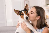 Beautiful Woman Hugging Her Dog At Home poster