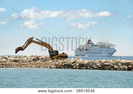 Building A Dike. Excavator Put Stones