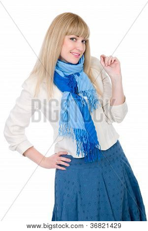 The Beautiful Blonde In A White Jacket And With A Blue Scarf Looks Directly