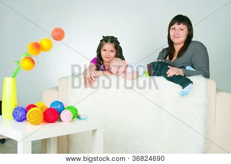 happy young woman with two children