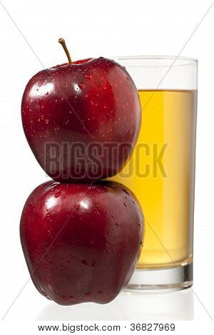 Stack Of Apples And Juice Glass