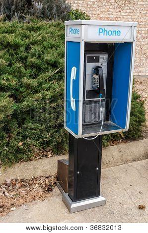 Pay Phone On A Sidewalk