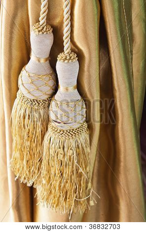 Curtain with golden tassel