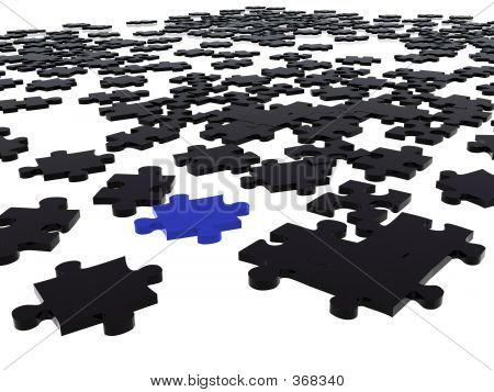 Black Puzzle Piece Amongst Black Ones