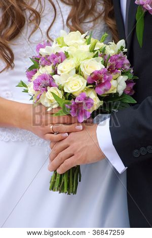 Couple with wedding bouquet
